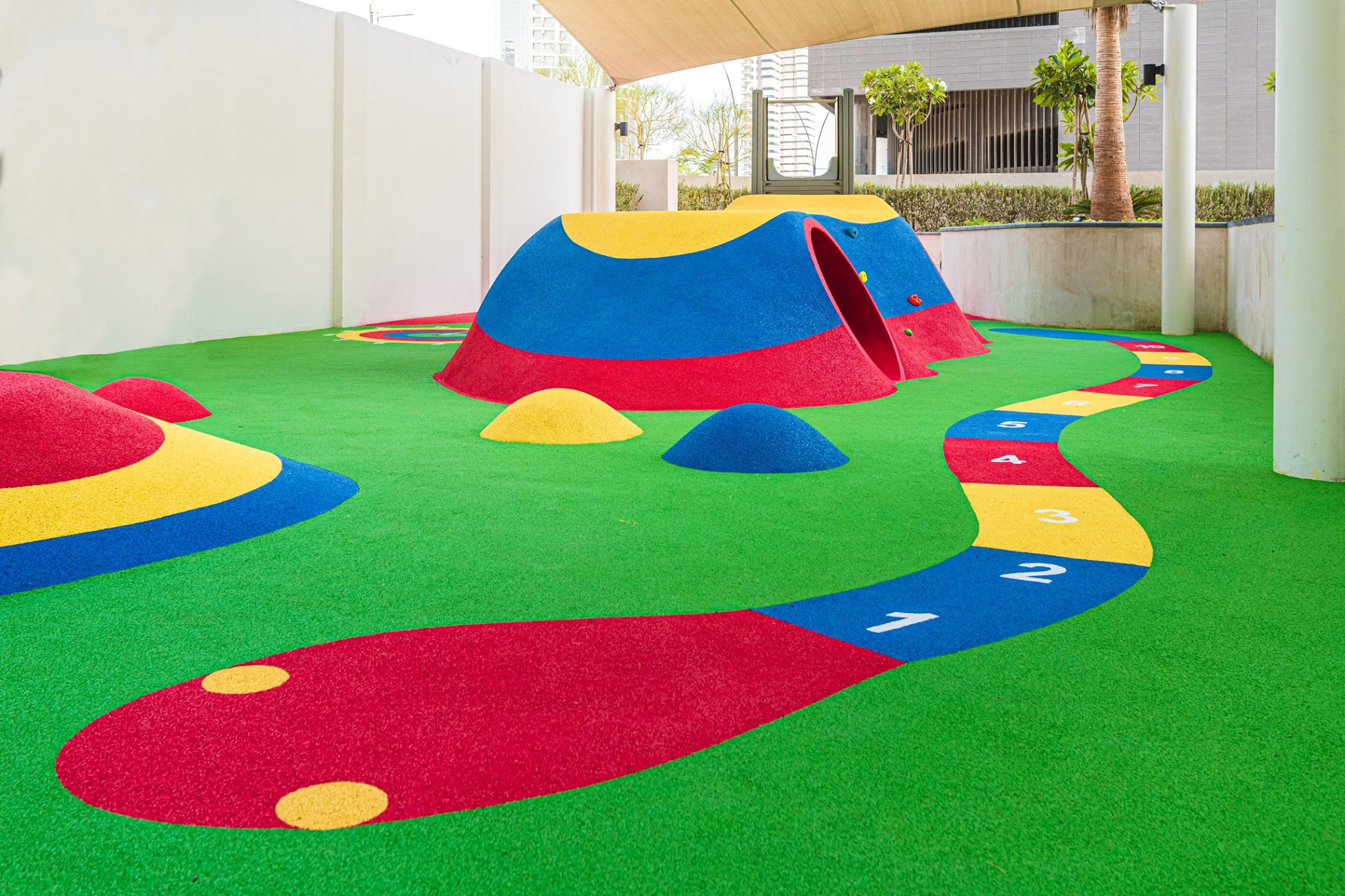 Colourful playground in Abu Dhabi surfaced with Rosehill TPV coloured rubber granules